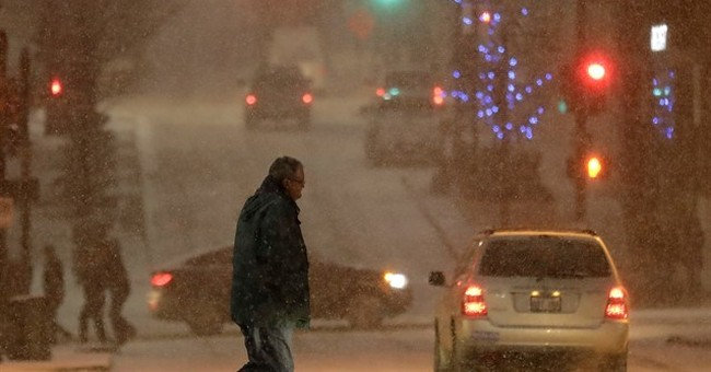 The Latest: Subzero temps set records; warmer weather ahead