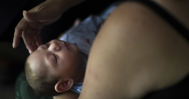Hard times for Puerto Rico family of child with Zika defect