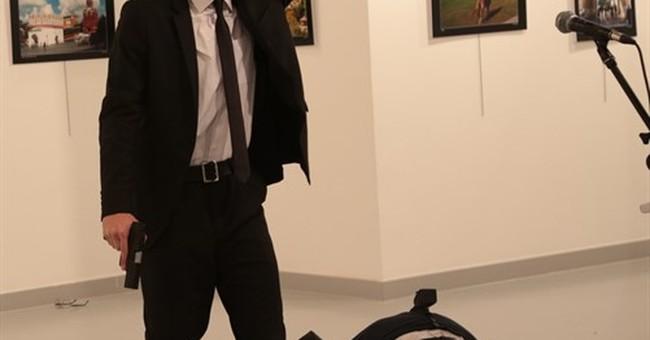 The Latest: China calls killing of Russian envoy 'barbaric'