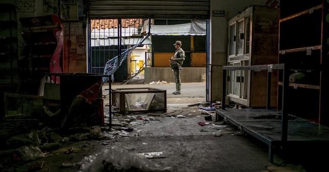 Looting leaves stores in ruins in Venezuela's Ciudad Bolivar