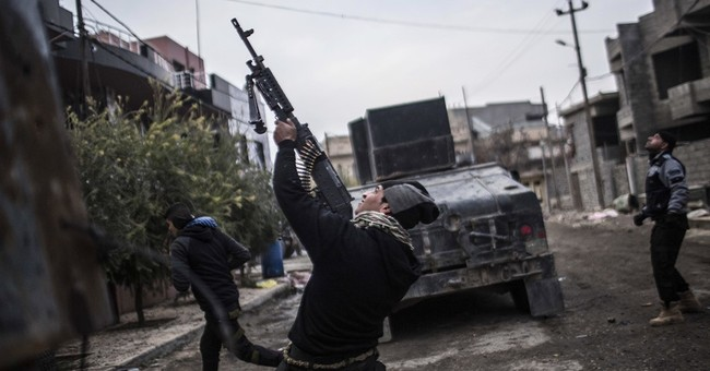 Fight for a Mosul district shows Iraqis' slow, painful slog