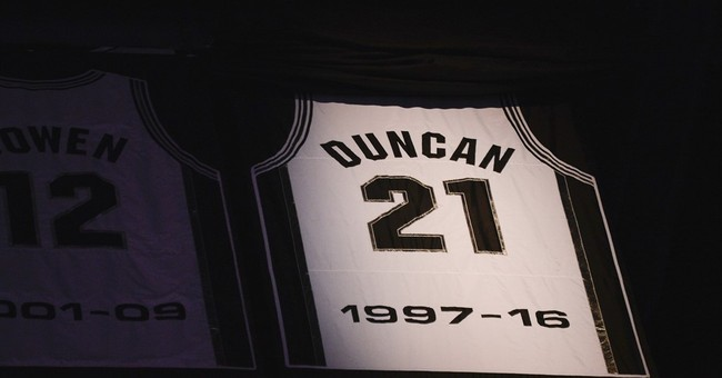 Photos show dad and son at Duncan's debut, jersey retirement