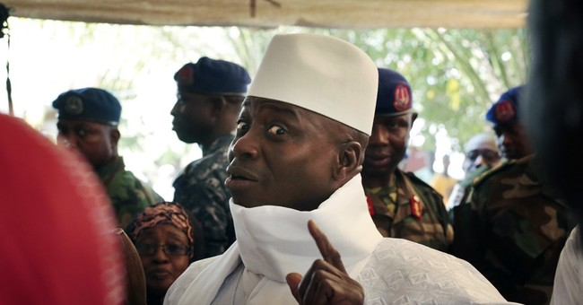 Defiant Gambia leader says only Allah can deny him victory