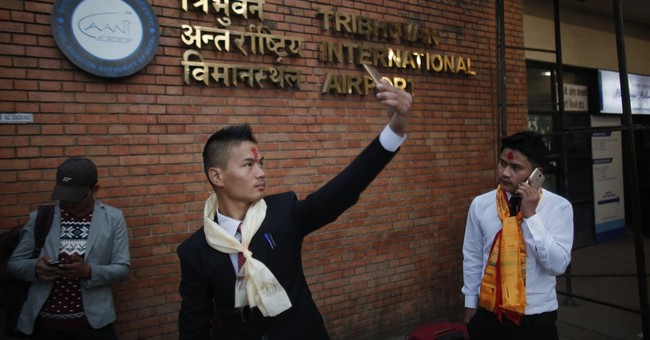 At soaring rate, Nepalis seeking jobs abroad come home dead