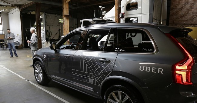 California puts brakes on Uber's self-driving car rollout
