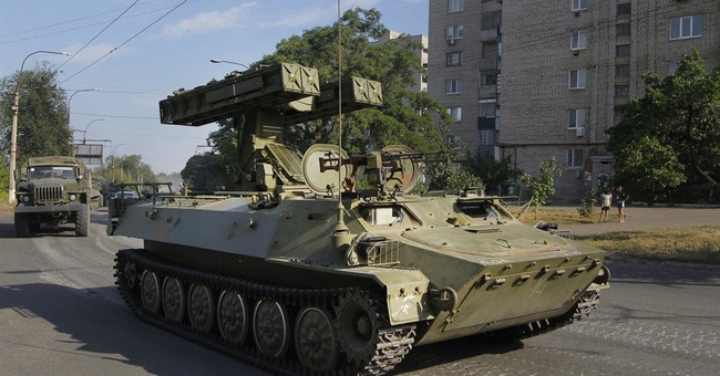Report: Russians regularly shelled eastern Ukraine in 2014