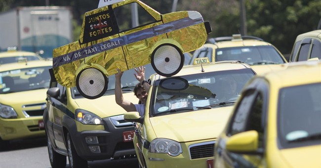 Uber looks to dominate in Brazil while taxis push to ban app