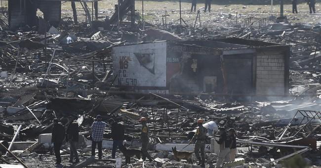 Mexicans mourn dead, seek relatives, after fireworks blast