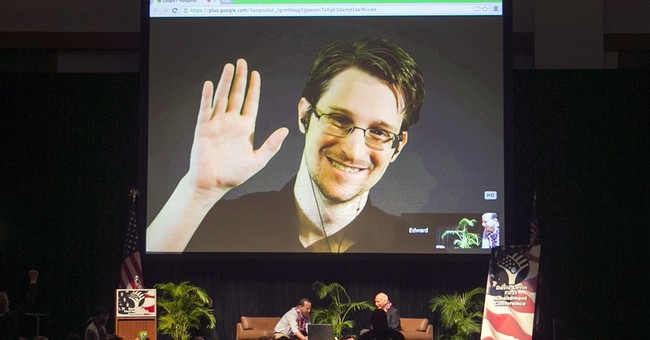 Inquiry says Snowden in contact with Russia's spy services
