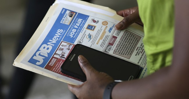 Applications for US jobless aid jump to still low 275,000