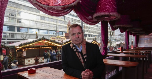 Defiance, not fear, as Berlin Christmas market reopens