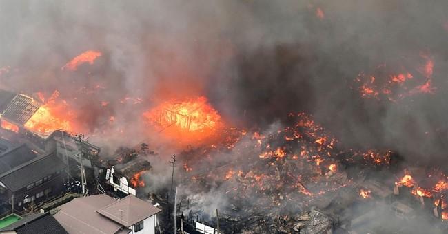 At least 140 buildings on fire in wind-swept blaze in Japan