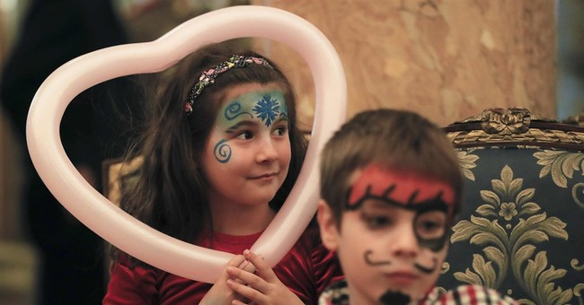 AP PHOTOS: Romania, Santa aid kids of dead, wounded soldiers
