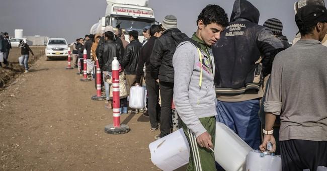 The Latest: Bombs in Iraq's Mosul kill 23