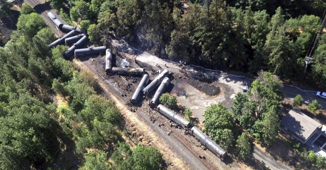 APNewsBreak: Railroad in fiery derailment agrees to changes