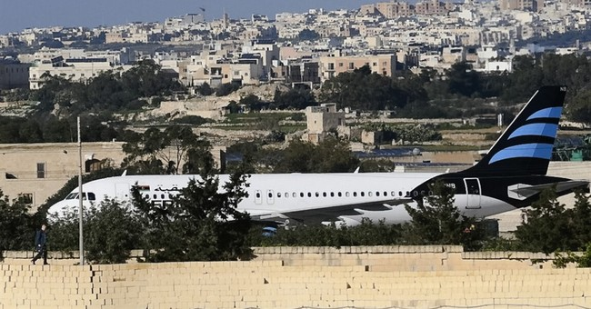 The Latest: Flights resume at Malta Airport after hijacking