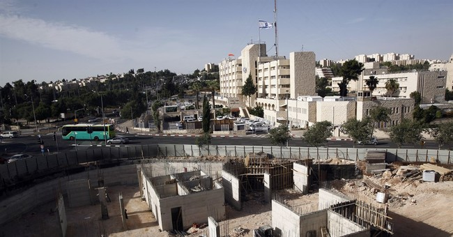 UN condemns Israeli settlements as Obama declines to veto