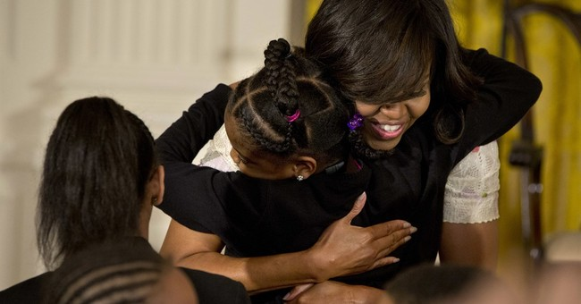 Michelle Obama offers empowering example for girls
