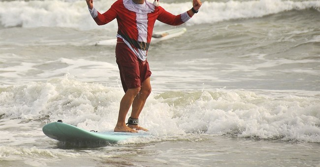 Yes, Virginia, there are surfing Santas in Florida