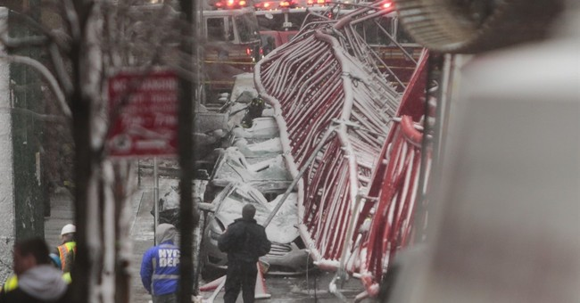 Manhattan crane topples into street killing 1, injuring 3