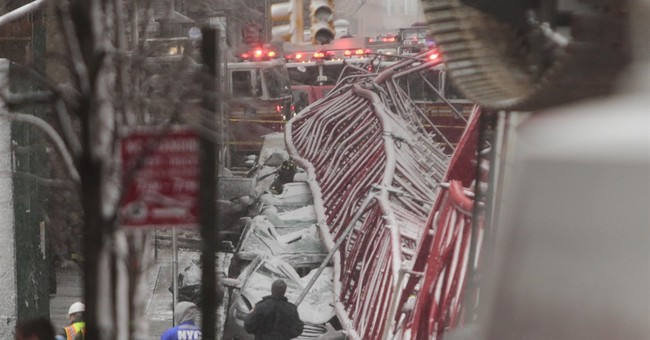 Manhattan crane topples into street killing 1, injuring 3