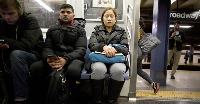 Subway riders dismiss NYPD plan to wake snoozing passengers