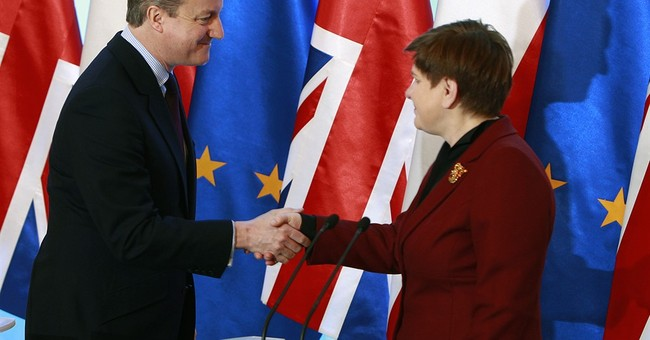 Poland says it wins protection for Poles in British EU deal