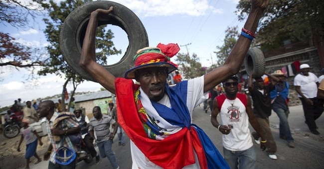 Former soldiers clash with protesters in Haiti; 1 dead
