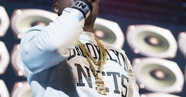 New York rapper shot, wounded sitting in car at intersection