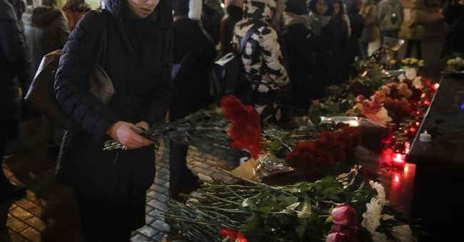 The Latest: Russian divers to work all night at crash site