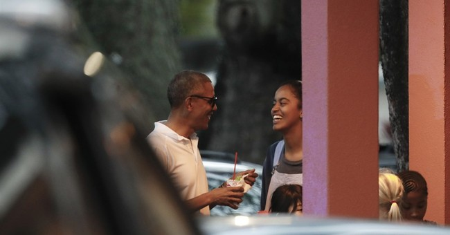 The Latest: Barack and Michelle Obama dining out in Honolulu