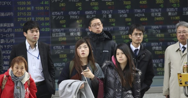 Asian stocks mixed in light trading ahead of New Year