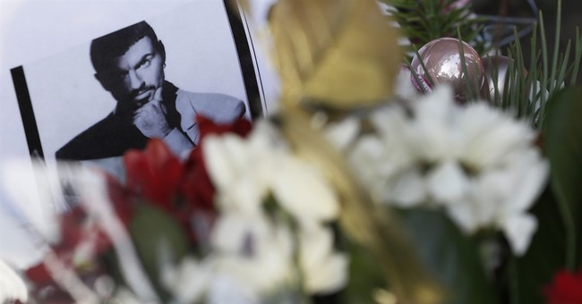 Fans mourn pop's George Michael as charities reveal his work