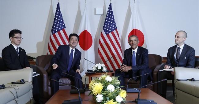 The Latest: Obama calls Japan's premier's visit 'historic'