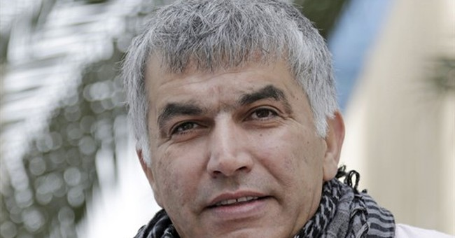 Bahraini activist, to be freed on bail, ordered held again