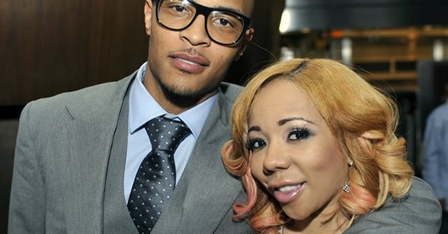 Rapper T.I. and his wife to split as she files for divorce