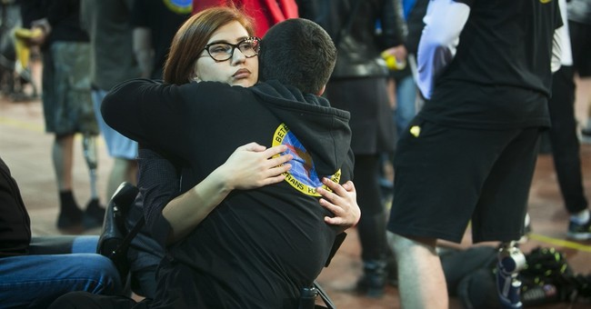 AP Photos: Ukraine's wounded soldiers get pumped up