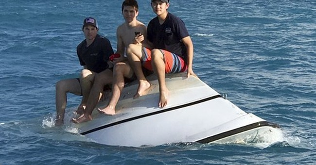 Correction: Capsized Boat-Teens Rescued story