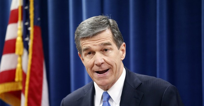 The Latest, NC: Law stripping gov.-elect's power blocked