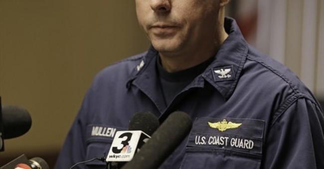 The Latest: Coast Guard suspends plane search; 6 onboard