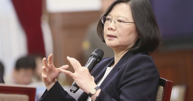 Taiwan leader urges China for 'calm' talks as pressure grows