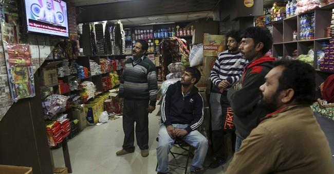 India's Modi defends decision to demonetize high-value bills