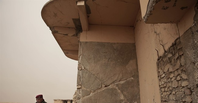 Turning Iraq history to rubble, leaving the mess to looters