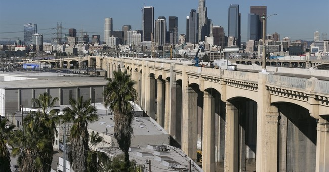 The Latest: Freeway reopens with demolition of LA bridge