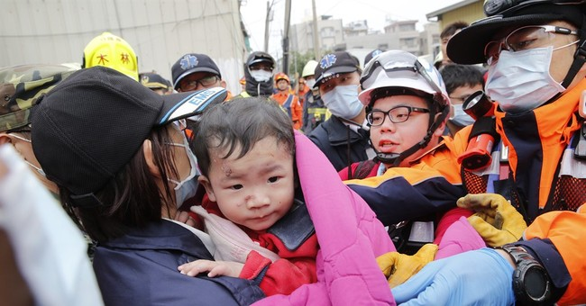 The Latest: More than 130 missing, 18 dead in Taiwan quake