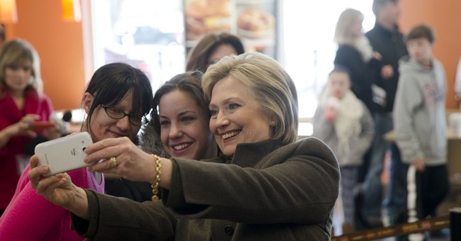 Clinton calls Flint water crisis 'immoral' in break from NH