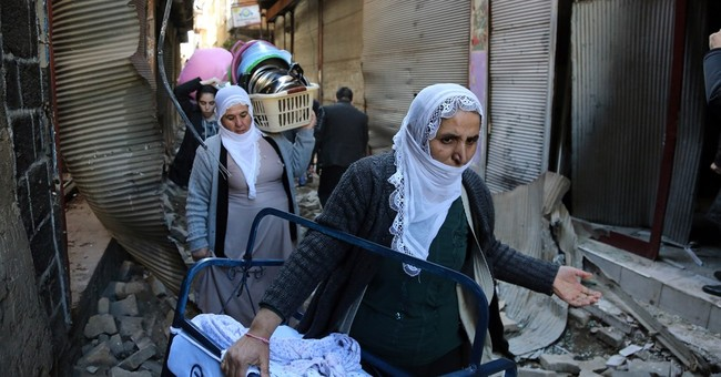 Displaced by fighting, Kurdish residents call for peace