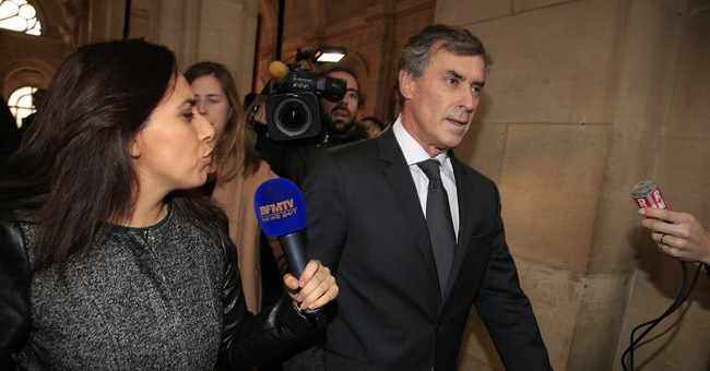 French ex-minister in court over tax fraud, money laundering