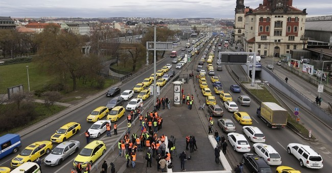 Taxi in Prague block traffic, demand higher pay, ban on Uber