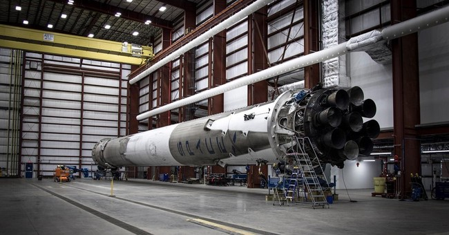 SpaceX's returned booster rocket back in hangar